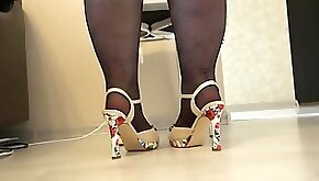 Thick legs put on tights with a pattern and high heeled shoes. Foot Fetish.