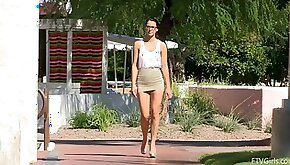 Alannah flashes tits and shaved pussy in a park