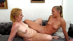 Mature and young blonde Karis and Glynis have lesbian sex