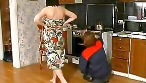 Mature brunette woman gets nailed hard in her own kitchen