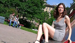 Fabulous young blonde babe sexy dress flashes her shaved pussy in the park