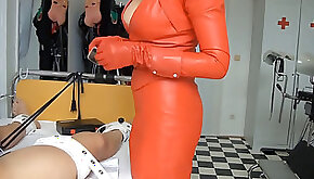 Domina in red leather