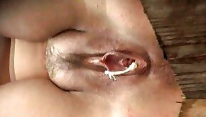 Babe toying pussy with pussy is pissing in the toilet