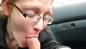 Redhead MILF Ivy sucks and swallows load in a parked car