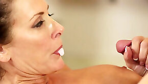 Busty mature gives massage and sex to much younger hunk